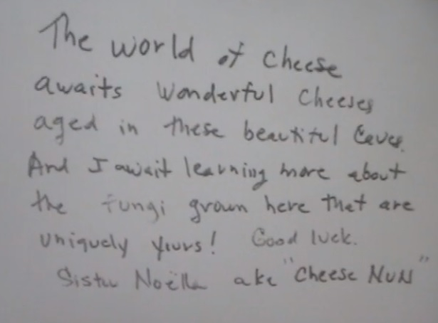 """a handwritten note: """"the world of cheese awaits wonderful cheese aged in these beautiful caves. And I await learning more about the fungi grown here that are uniquely yours! Good luck. Sister Noella aka """"Cheese Nun"""""""""""