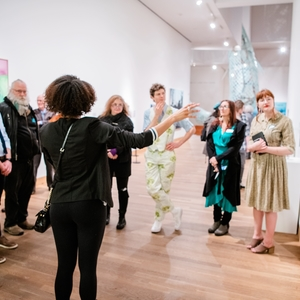 Image Description: An instructor teaching in an art gallery